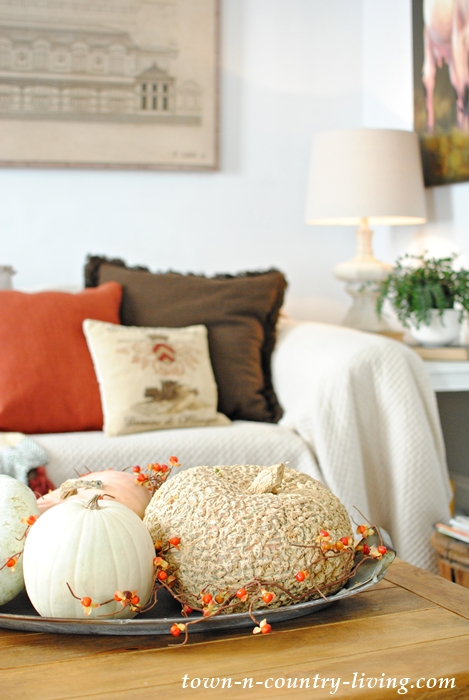 Family room decorated for fall with warm colors