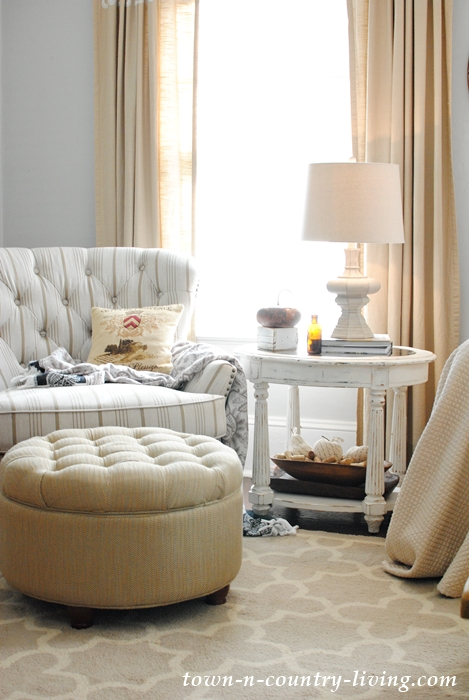 Tufted chair and ottoman in farmhouse family room