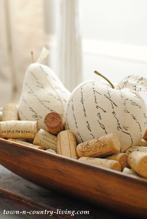 Wine corks and script fruit for a fall vignette