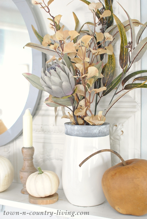 Fall floral bouquet in gray and white stone vase