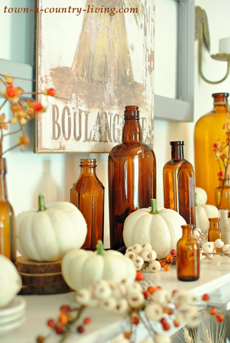 Vintage Fall Mantel with my favorite brown bottles from the flea market