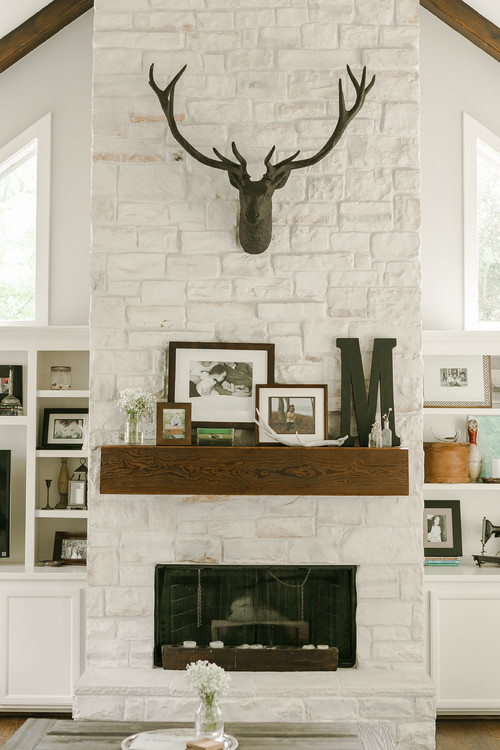 Country Farmhouse Family Room with Stone Fireplace