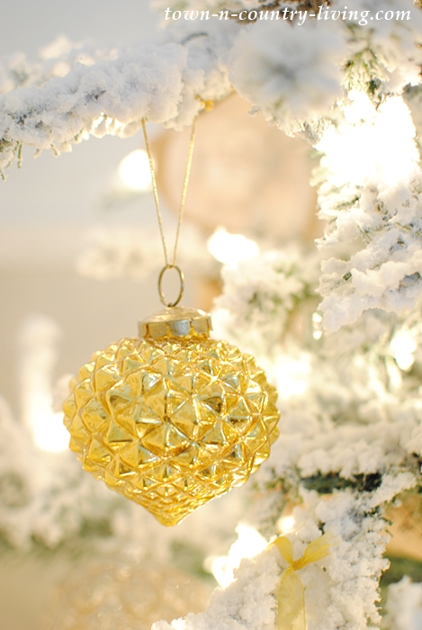 Golden Ornament on Flocked Christmas Tree