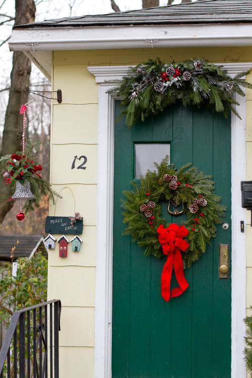 Yellow Cottage with Dark Green Door Decorated for Christmas
