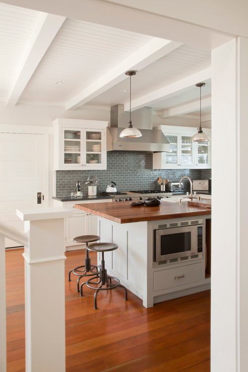 Beach style kitchen with butcher block counter tops