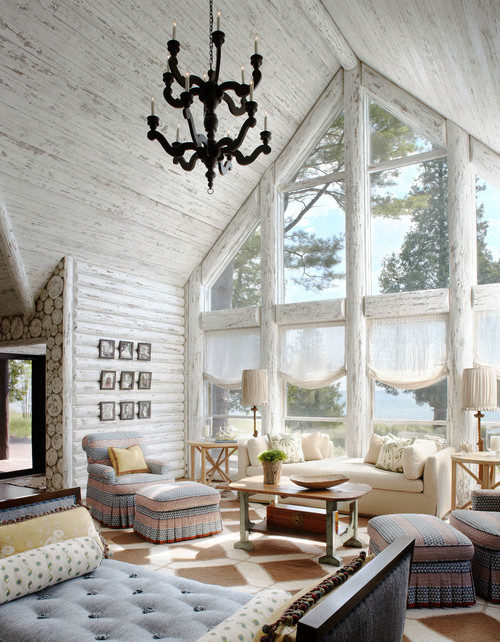 Rustic living room in whitewashed lake cabin
