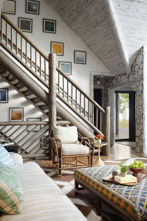 Rustic staircase in a whitewashed lake cabin