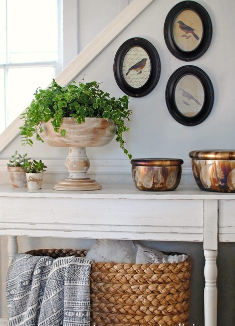 Styling a Console Table with Plants and Pictures