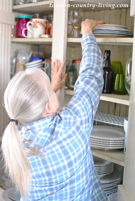 Organizing Dishes in a Kitchen Cabinet