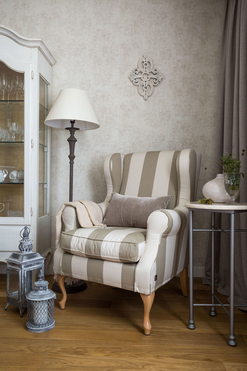 Traditional Living Room with Striped Wing Chair