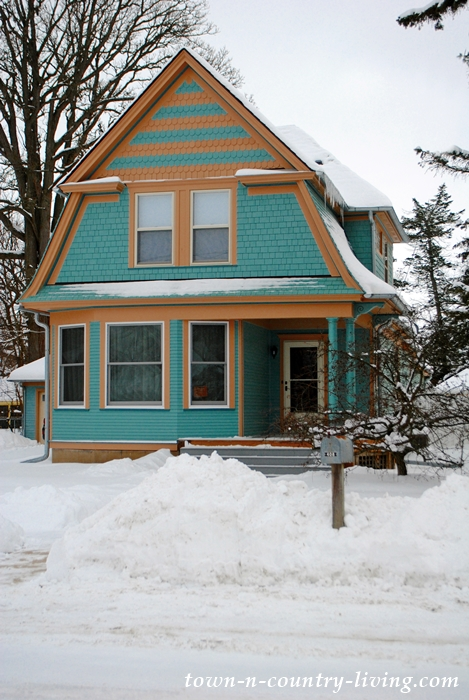 Blue Cottage in the Snow