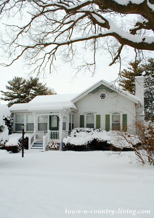 White Historic Cottage in the Snow