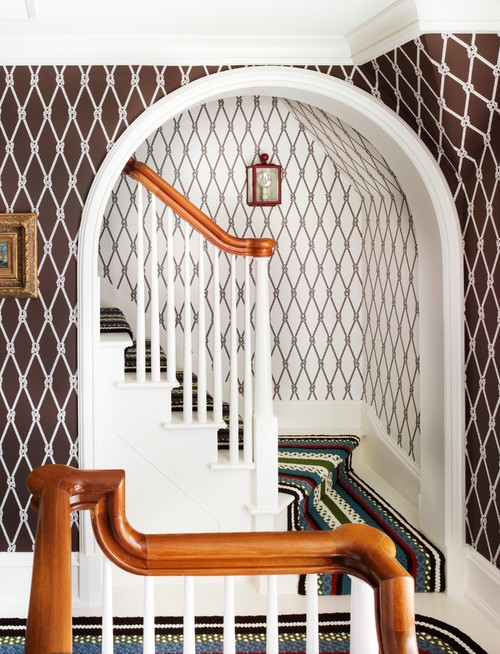 Traditional Staircase with Brown Wallpaper
