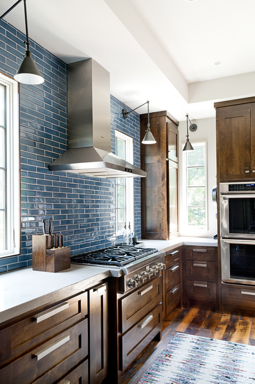 Kitchen with Rustic Wood Cabinetry and Blue Tile