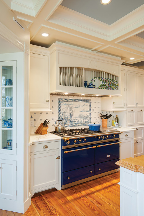 Blue Stove in Farmhouse Kitchen with delft tile. Come see 36 Best Beautiful Blue and White Kitchens to Love! #blueandwhite #bluekitchen #kitchendesign #kitchendecor #decorinspiration #beautifulkitchen
