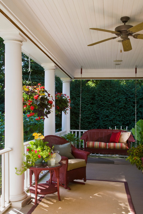 Traditional Front Porch with Red Wicker Furniture