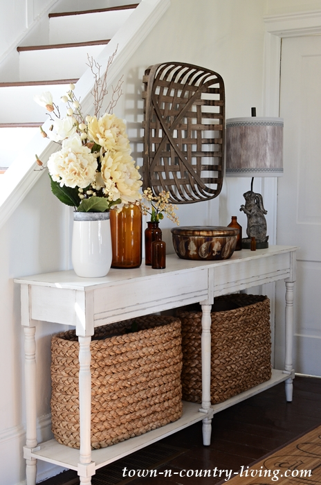 Farmhouse Console Table Styled with Baskets and Bottles