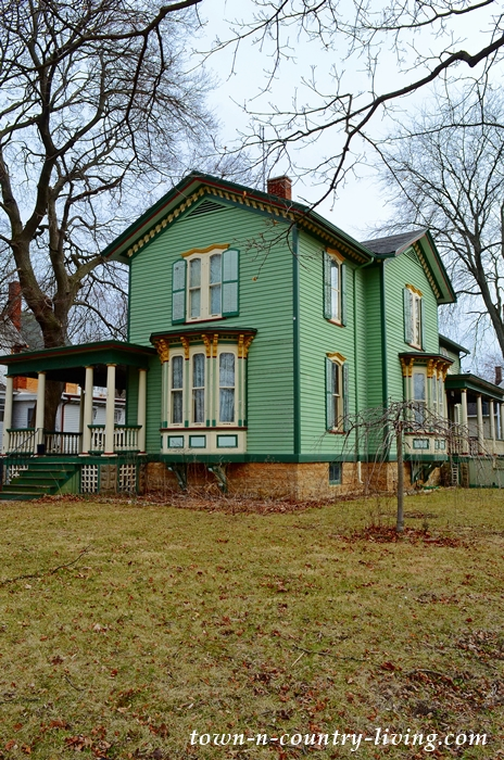 Green Clapboard Victorian House with Bay Window