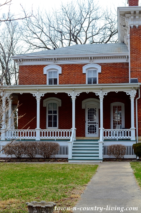 Red Brick Italianate Historic House with White Trim and Cupola