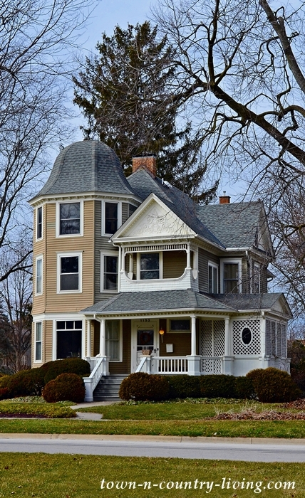 Tan 3-Story Victorian Home in Aurora Historic District
