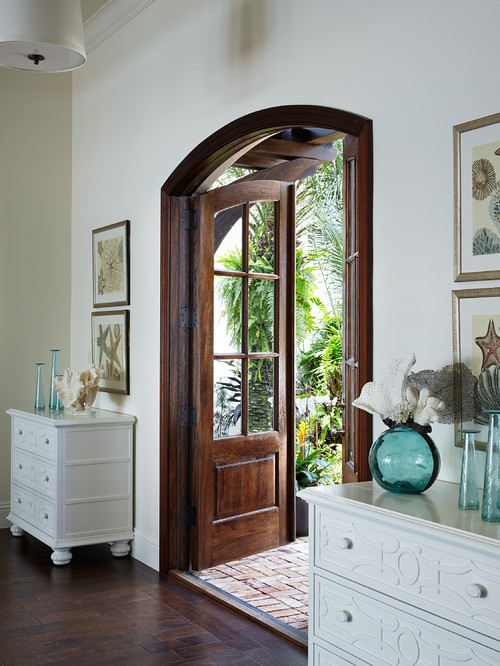 Double front door in beach style entry