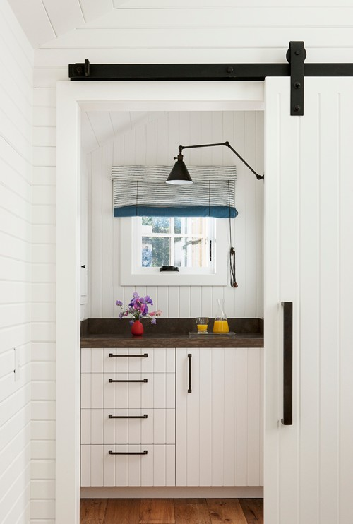 White Cottage Kitchen with Sliding Barn Door