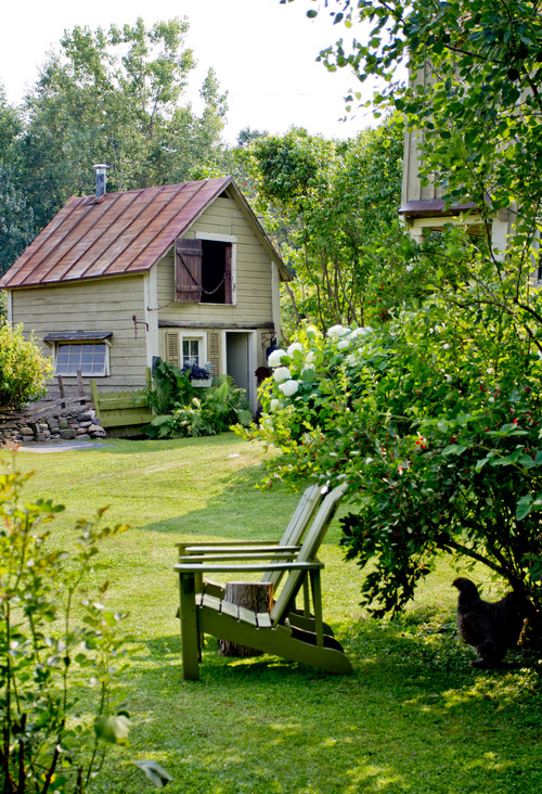 Country Garden with quaint shed and Adirondack chairs
