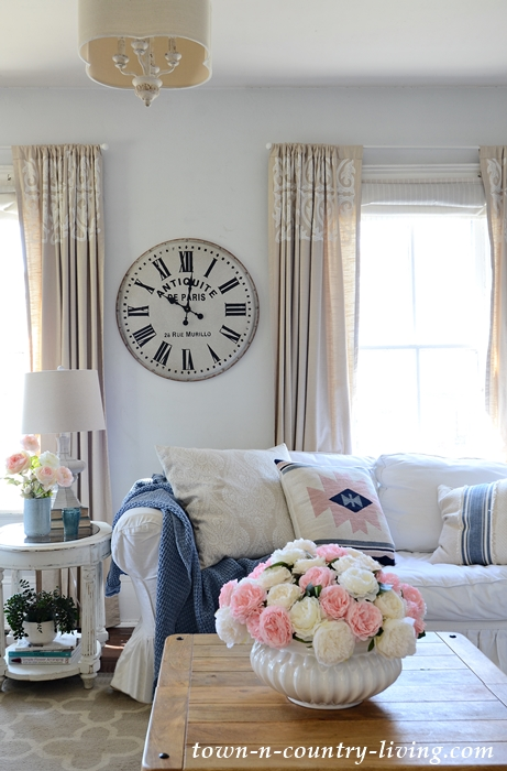 Create a Cozy Spring Family Room with Flowers and Pillows