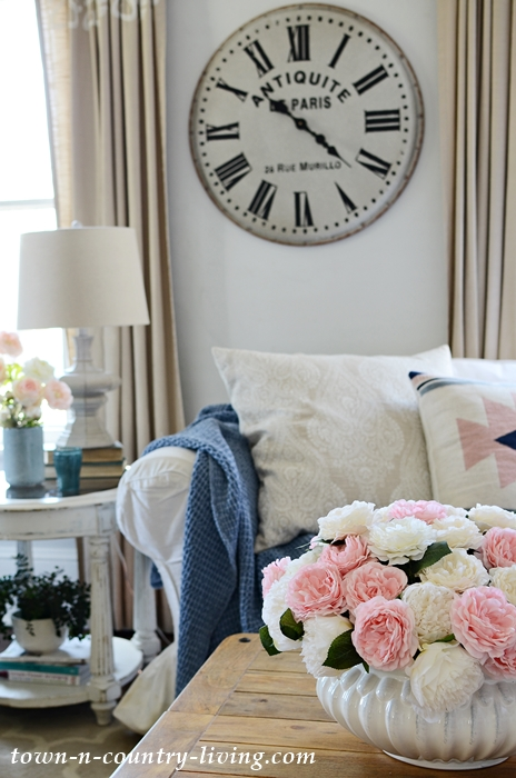 Cozy Spring Family Room with Flowers and Pillows