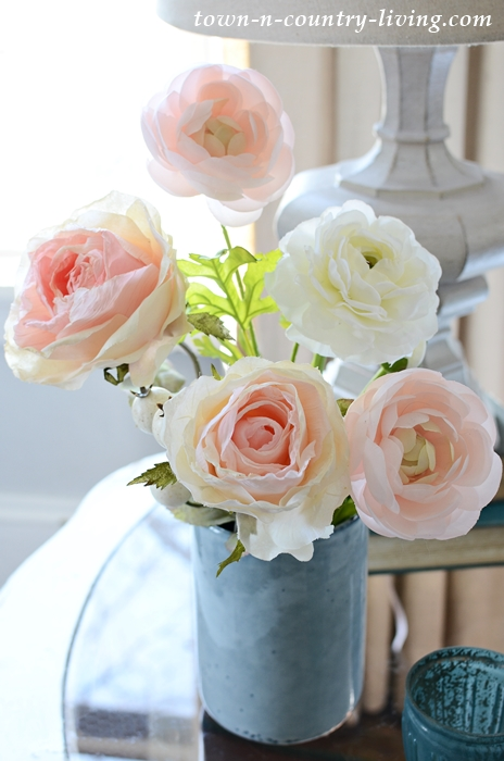 Faux Roses in a Light Blue Vase