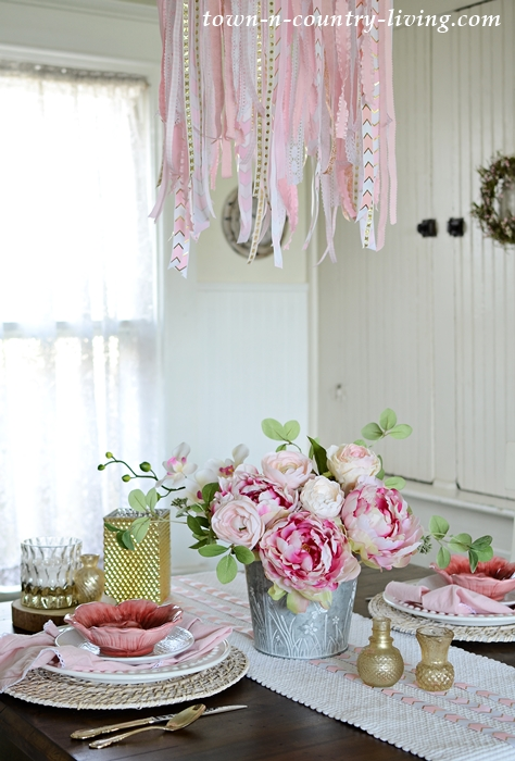 Ribbon Chandelier and Pink and White Table Setting in Farmhouse Breakfast Nook