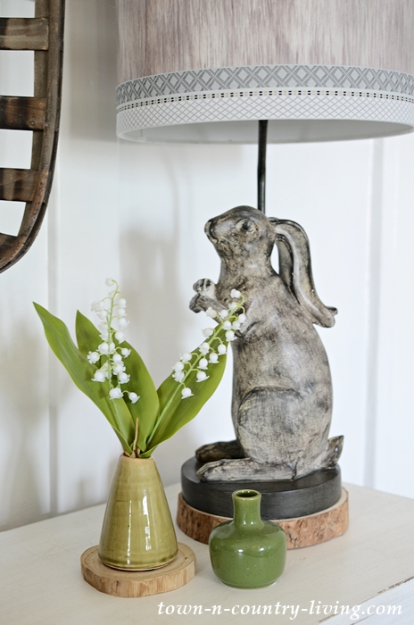 Farmhouse Vignette with Green Vases, Lily of the Valley, and a Rabbit Lamp