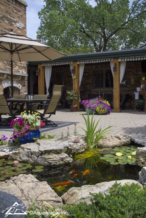 Backyard Pond and Waterfall with Dining Area