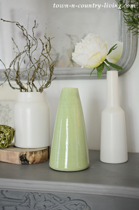 Vignette of Green and White Vases on Summer Mantel