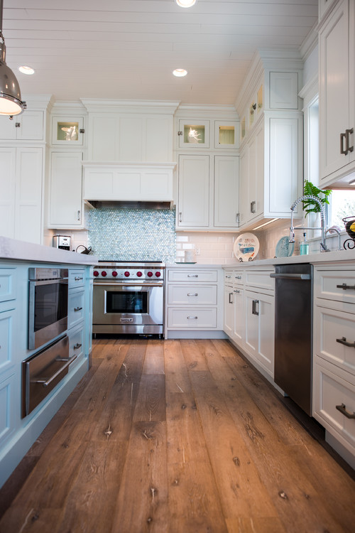 Coastal style kitchen with iridescent blue tile