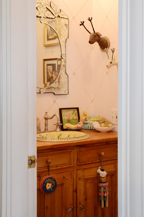 Powder Room with Antique Vanity and Embossed Mirror