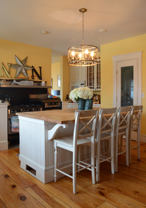 Yellow and White Country Style Kitchen with Bead Board Island