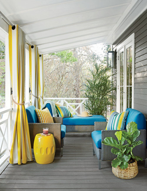 Bright Blue and Yellow Cushions and Pillows on the Front Porch