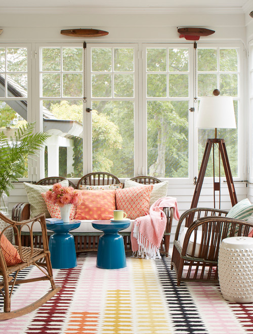 Brightly Colored Rug and Pillows in Windowed Sun Room