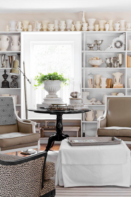 McCoy pottery in creamy whites, paired with old silver and vintage books