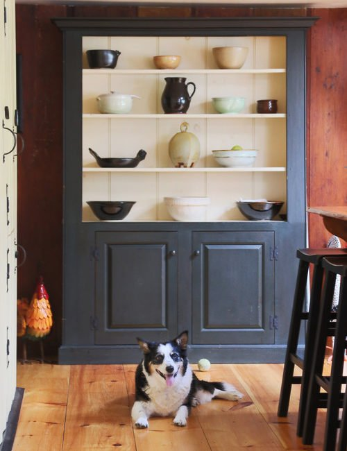 How to display pottery in a vintage farmhouse cupboard.