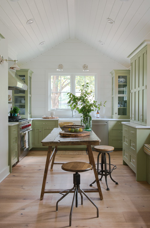 Farmhouse Kitchen with Light Green Cabinets and Shiplap Walls
