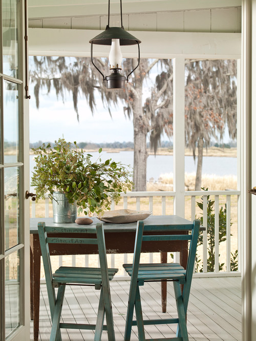 Simple Southern Porch with Farmhouse Table and Wood Folding Chairs
