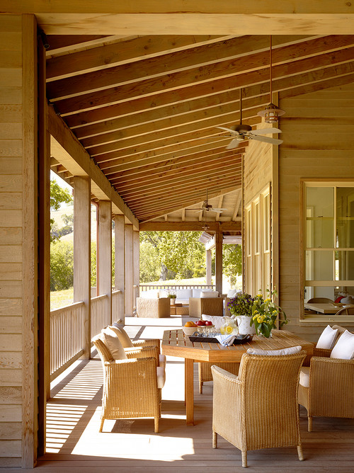 Traditional Porch with Rattan Furniture and Dining Set