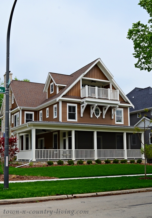 Large Brown and White Victorian Home with Wrap Around Porch