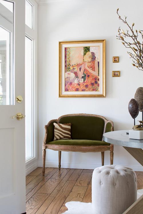 Entryway with green velvet settee