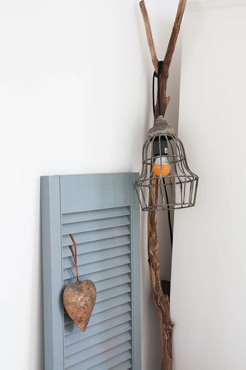 Repurposed farmhouse light fixture and blue shutter