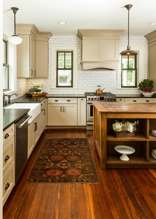 Farmhouse Kitchen with Wood Floors and Taupe Cabinets