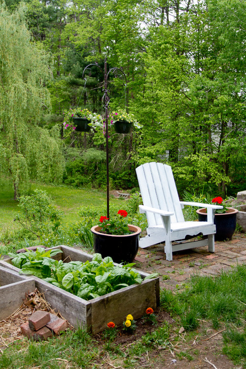 White Adirondack Chair in Cottage Garden