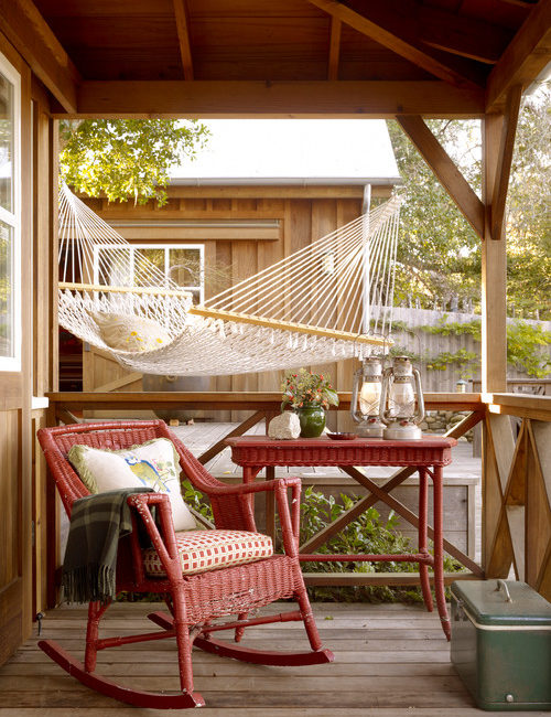 Red Wicker Rocking Chair on Front Porch